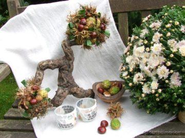 Herbstdeko mit Kastanien und Haselnüssen